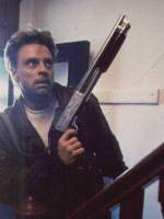 Man (Mark Hamill) with shotgun. Still shot from Time Runner.